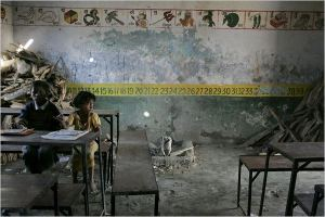 Two children at a ramshackle government school in Bihar. Picture Courtesy: New York Times
